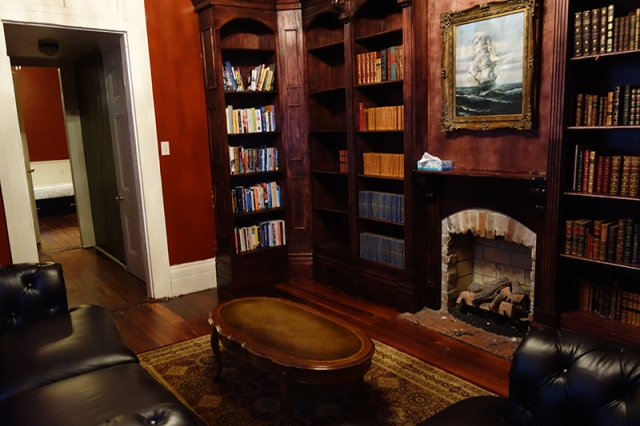 The residence library, with working gas fireplace.